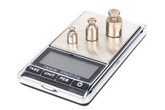 Digital scales with iron weights Royalty Free Stock Image