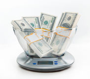 Digital scales with money Royalty Free Stock Image