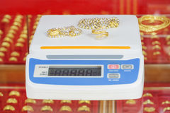 Digital scales for weighing gold rings and necklaces. In store Royalty Free Stock Photography