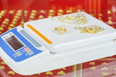 Digital scales for weighing gold rings and necklaces. In store Royalty Free Stock Photos