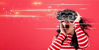 Digital Screen with woman using a virtual reality headset royalty free stock images