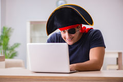 The digital security concept with pirate at computer Stock Images