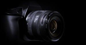 Digital single-lens reflex camera. With black background stock image