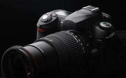 Digital SLR Camera. A dslr camera with zoom lens attached on black background Stock Image