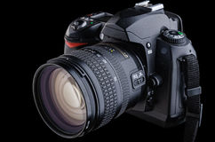 Digital SLR camera. On a black background Stock Photo