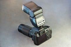 Digital SLR Camera Body Lens and Flash on Gray Royalty Free Stock Photos