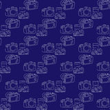 Digital SLR camera on a dark blue background. Seamless pattern Stock Photography