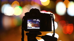Digital SLR camera filming night city traffic. stock video