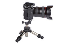Digital slr camera and mini tripod Royalty Free Stock Images