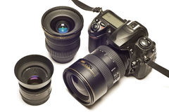 Digital SLR With Lenses Revised. Horizontal shot of a black digital camera with two extra lenses Stock Photos