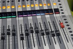Digital sound board used to mix audio stock photo