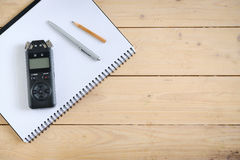 Digital sound recorder and other accessories on the wooden table, Stock Photography