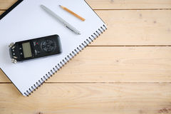 Digital sound recorder and other accessories on the wooden table, Royalty Free Stock Photo