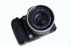 Digital Still Camera. Isolated on white with narrow focus on the lens Royalty Free Stock Images