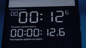 Digital stopwatch timer counting seconds on device screen