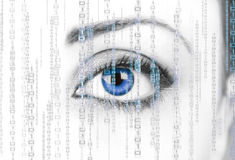 Digital Surveillance. Woman eye ice blue background with binary code Stock Photography