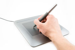 Digital tablet. And pen in a hand Royalty Free Stock Photo