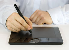 Digital Tablet. A hand drawing on a computer graphics tablet Stock Photos