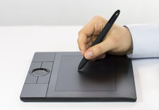 Digital Tablet. A hand drawing on a computer graphics tablet Stock Images