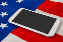 Digital tablet on American flag Royalty Free Stock Photo