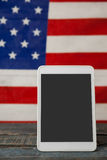 Digital tablet on American flag Stock Images