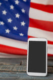 Digital tablet on American flag Stock Photography