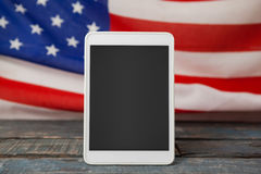 Digital tablet on American flag Royalty Free Stock Image