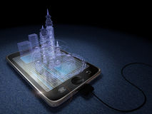 Digital Tablet And Futuristic Town Royalty Free Stock Photo