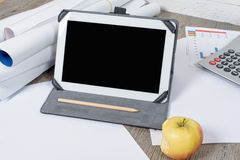 Digital tablet with apple Stock Image