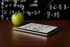 Digital tablet and apple Royalty Free Stock Image