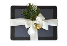 Digital tablet as a Christmas gift isolated on white Royalty Free Stock Images