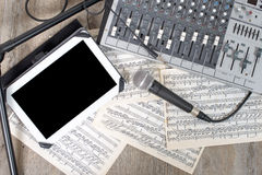 Digital tablet and audio mixer Stock Photography