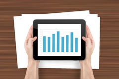 Digital Tablet with Bar Chart and Sheet Stock Images