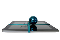 Digital tablet with blue ribbon and blue Christmas ball isolated on white Royalty Free Stock Photography