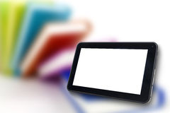 Digital Tablet with Books blackground Stock Photo