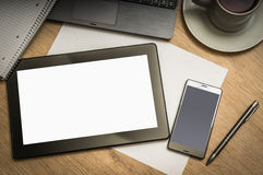 Digital tablet on business table with blank white screen Royalty Free Stock Photography