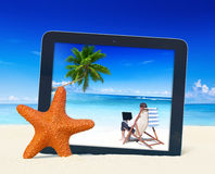 Digital Tablet with Businessman Working on the Beach Concept Royalty Free Stock Image