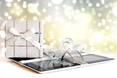Digital tablet with christmas present Royalty Free Stock Image