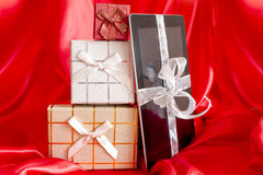 Digital tablet with christmas present Stock Photos