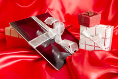 Digital tablet with christmas present Royalty Free Stock Images