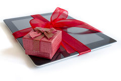 Digital tablet with christmas present Royalty Free Stock Photography
