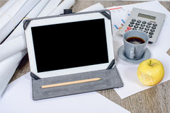 Digital tablet with a coffee and an apple Royalty Free Stock Photo