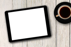 Digital tablet and coffee cup Royalty Free Stock Photos