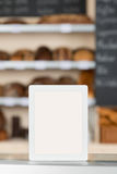 Digital Tablet On Coffee Shop Counter Royalty Free Stock Photo