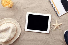 Digital tablet computer with blank screen and beach items Stock Photos