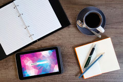Digital tablet computer with note paper and cup of coffee Stock Photos