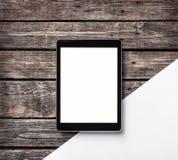 Digital tablet computer on wooden desk. Stock Photo