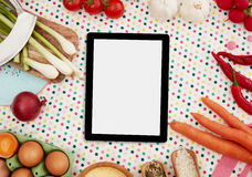 Digital tablet and cooking ingredients Stock Image
