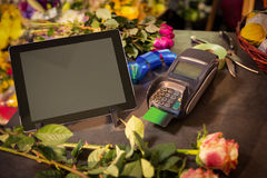 Digital tablet and credit card terminal on the table Stock Images