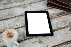 Digital tablet with cup of coffee Royalty Free Stock Photography